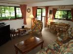 The cosy cottage living room. Enjoy the breathtaking views and watch the amazing variety of birds.