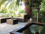 Shaded Seating area with fish pond