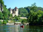 Floating downstream past La Roque-Gageac - voted one of France's most beautiful villages.