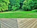 Hazel cottage: uninterrupted views from rear decking across sweeping lawns to the woodland beyond
