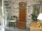 Natural stone walls & country furniture in Doyle's Cottage hall add to its unique character!