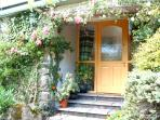 Delightful front entrance to Horseshoe Cottage from the courtyard garden