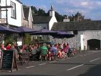 One of the popular pubs on a summer's evening by the sea-front