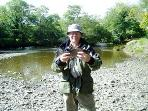 A very happy guest with his catch - a very nice grayling