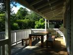 Outdoor seating and BBQ area.