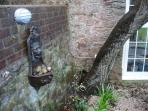 Quirky lion detail for the garden lover