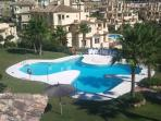 Large Swimming pool and garden area, ideal for relaxing on the sunbeds which are provided.