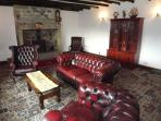 comfy sitting room   0riginal oak beams   inglenook fireplace   wood burning stove..