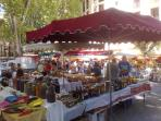 Sample regional foods such as wines and cheeses at local markets