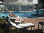 The additional and superb wrap around communal pool .