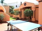 Front of house and top garden, with table tennis table