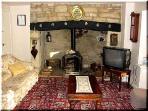 Lounge showing inglenook with wood burning stove, t.v. now flatscreen