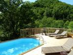 Pool and sundeck with mountain views