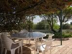 shady dining area under the pergola