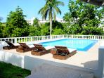 Private swimming pool also BBQ enclosed in a beautiful fruited garden total land area 1 + 1/2 acres