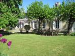 The garden has table and chairs where you can eat or relax under the chestnut tree.