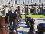 Giant chess in cloister gardens