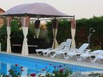 Fabulous area around the heated swimming pool to take in the rays