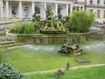 Stroll to Neptune's Fountain in the Promenade shopping area