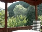 Extensive views over the gardens and valley beyond from 'Kozle's open air balcony