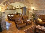 stone arches, barrel vaulted ceiling, high wooden beams, terra cotta floors, flagstone staircases -