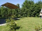 the private garden with covered picnic table and barbecue