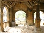 The old market hall on the high street and approximately 50 paces from the The Honeypot!