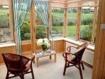 Conservatory connected to kitchen, overlooking garden and fields beyond - perfect for summer days!