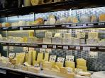 Inside the fabulous cheese shop, right on the corner. One of the best in Paris.