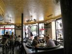 The convivial Cafe Charlot. There are many other cafes on the same street.
