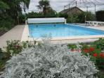 The Swimming Pool set in a large terrace with flower beds and lawns