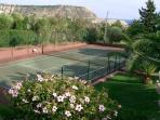 Private tennis court in the garden.