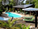 4 x 8 m pool with deck chairs, umbrellas and solar system