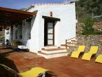 Large covered terrace and adjoining pool terrace and barbeque area.