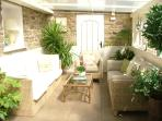 Relax in the sunny conservatory reception