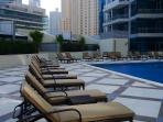 Communal pool and sun deck, free for use by guests