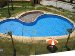One of the many swimming pools - this is the quietest and is at the front door below your balcony.