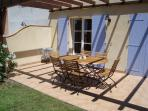 Terrace with teak garden furniture