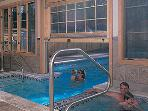 Indoor Spa areas with Saunas, Hot Tubs, Swimming areas, and links to the Outdoor pools.