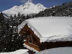 Log cabin in a winter wonderland with stunning views