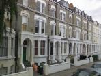 The road with lovely traditional Victorian London buildings.