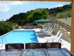 Dine al fresco beside the infinity pool, BBQ & Jacuzzi