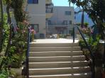 Steps adjacent to apartment leading to pool
