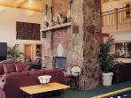 Large lodge lounge for relaxing by the fireside, kids movies, games and more