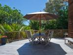 Relax and enjoy the sunshine and native bush, only a short level walk from the beach