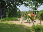 The childrens play area with trampoline and swings along  with a games room with pingpong and pool