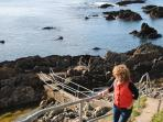 Enjoy the cliff walk and exploring the rock pools.