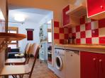 Espacio cocina con mesa-bara 2 personas