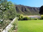 Private walled garden with panoramic views to the majestic mountains.