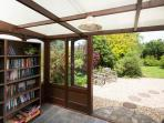 Sun room -  with reading chair, coffee table, selection of books & games for your use